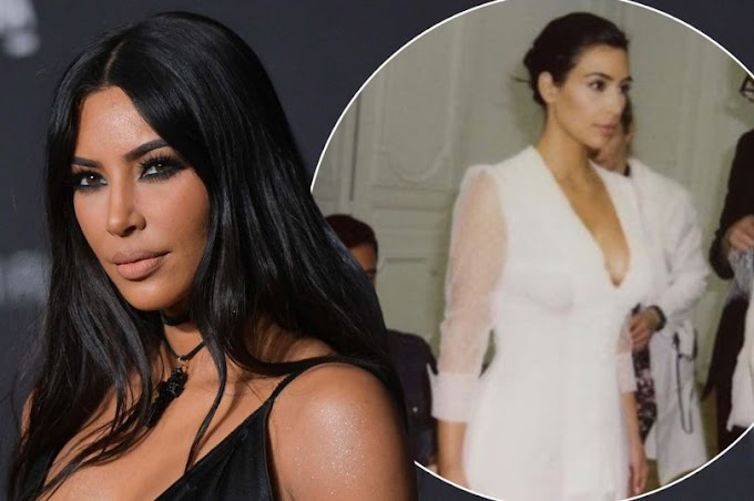 Kim Kardashian shares pics from wedding to Kanye West - but he's not in any of them