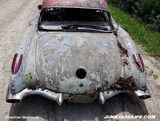 Weathered paint on trunk of 1959 Corvette.