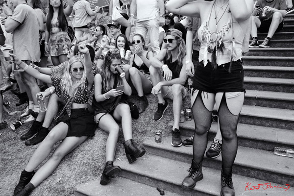 Friends hang out beside the Fleet steps, a convenient location. Harbour Life Music Festival Sydney 2016. Photographed by Kent Johnson for Street Fashion Sydney.