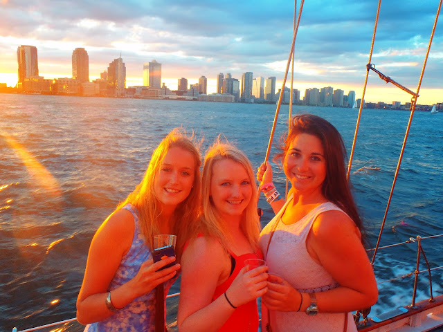 Girls sailing on Hudson River New York at Sunset