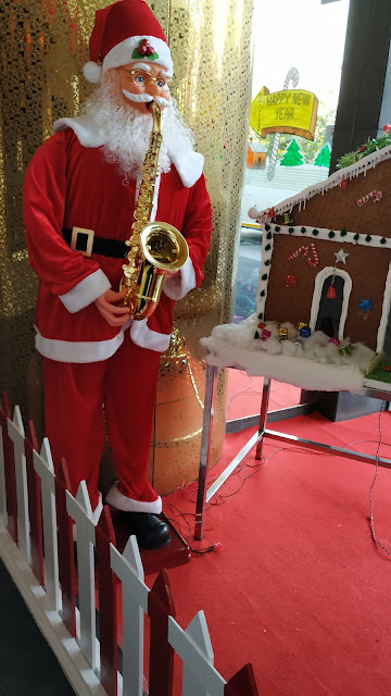 Santa Claus with music instrument in Hotels