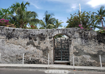 limestone wall with deorative gate