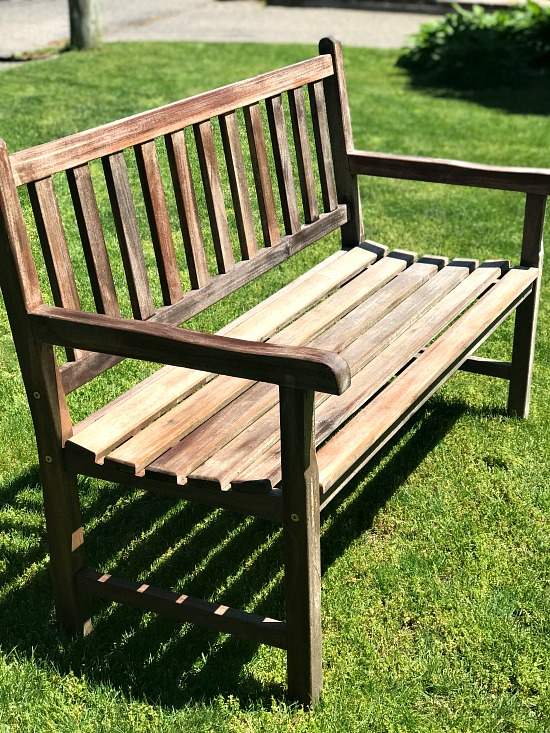 Teak bench drying on the lawn