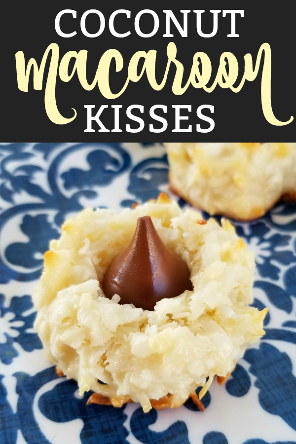 A tender and light, yet rich and dreamy recipe for chewy coconut cookies topped with Hershey's Kiss chocolate drops.