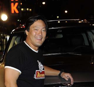 Polly Tsai's husband Ming Tsai posing for picture