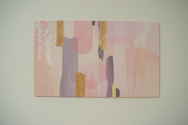 Completed framed and displayed gold, pink and grey canvas.
