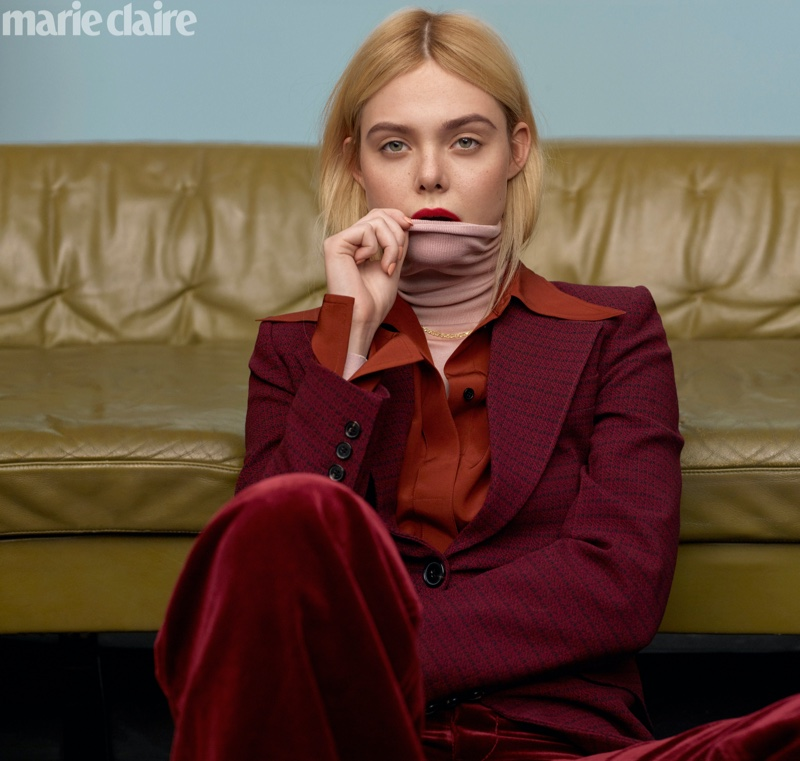 Elle Fanning poses in Victoria Beckham jacket, top and turtleneck with Marc Jacobs pants