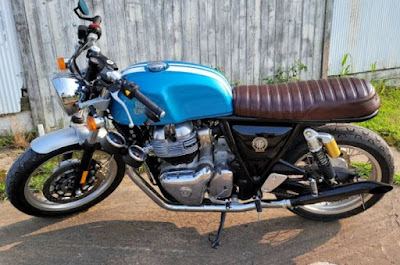 Royal Enfield with side mounted instruments.