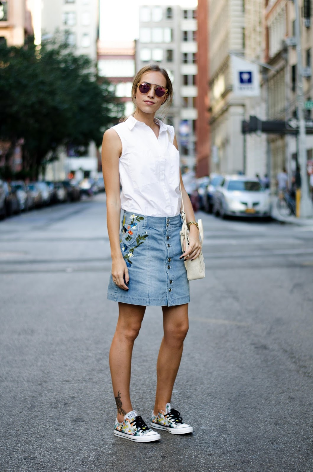 white sleeveless shirt denim skirt sneakers outfit