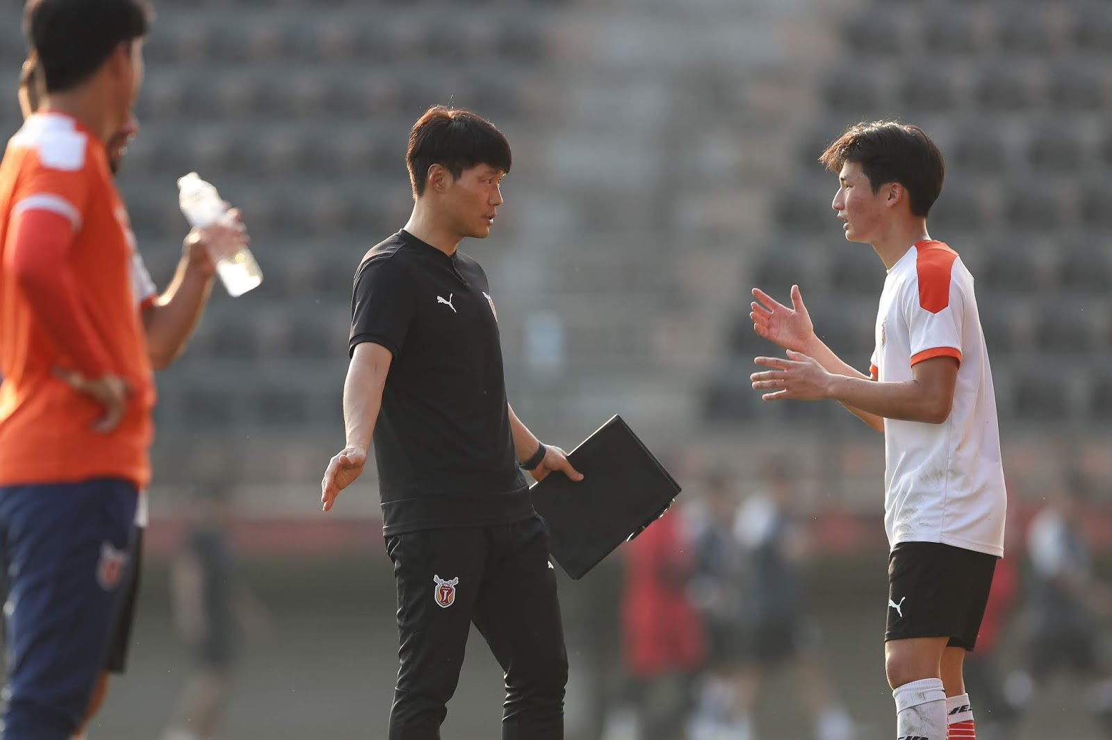 Jeju United training in Chang Rai, Thailand, February 1st, 2020. Nam Ki-il instructs Lee Dong-ryul.