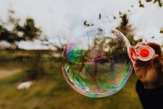 person-blowing-soap-bubble