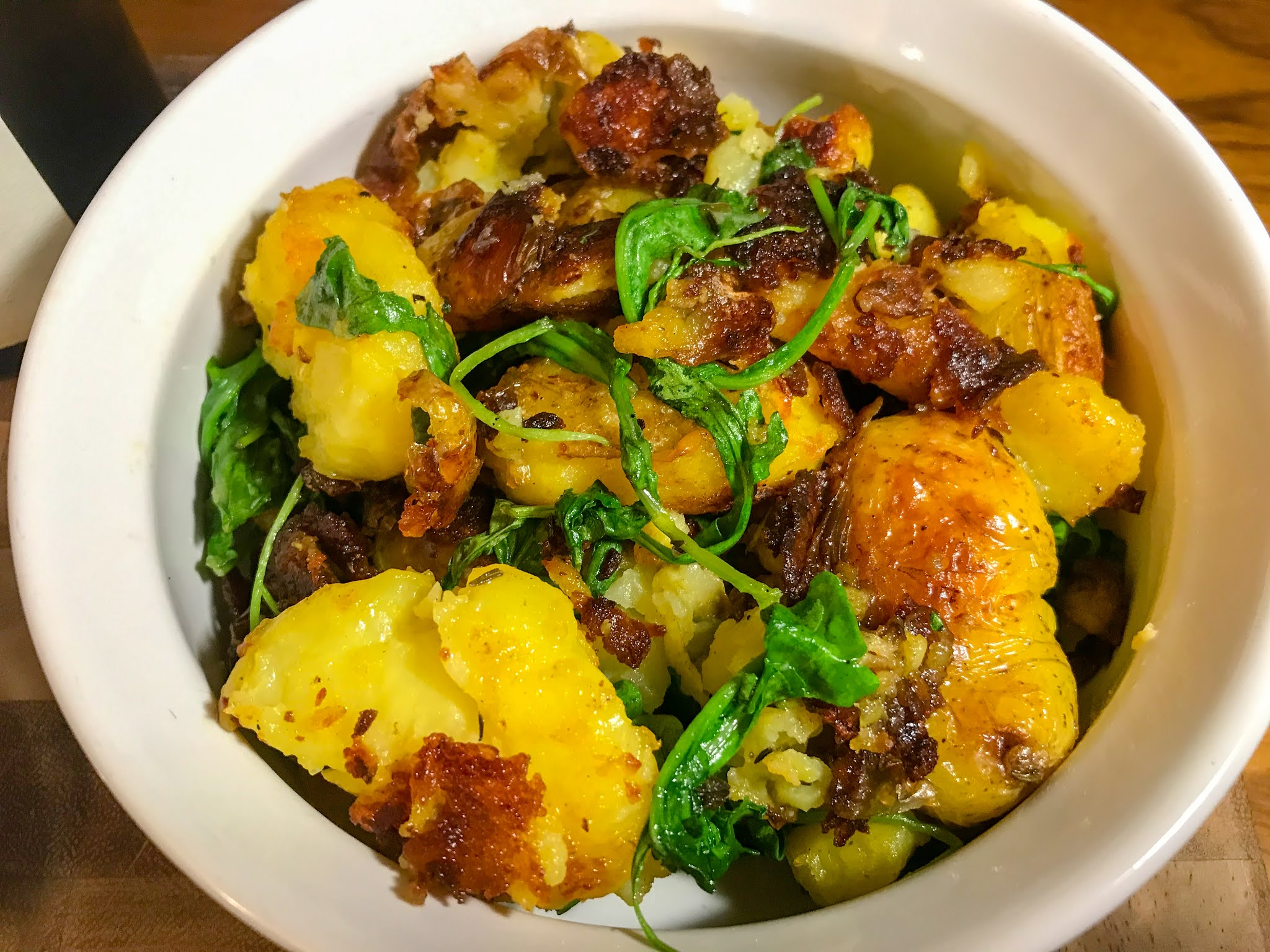 Smashed Potatoes with Herbs and Arugula