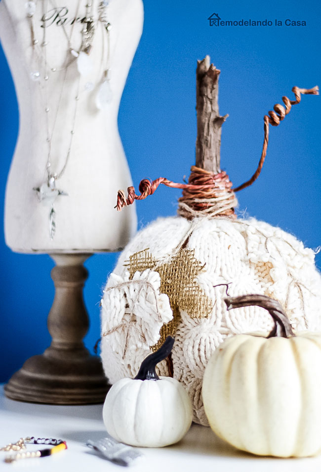 white pumpkins, french bust to hold jewelry, white side table