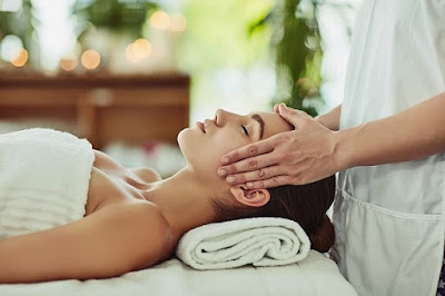 Image That Shows A Woman Experiencing A Soothing Massage Therapy From a Professional Massage Therapist.