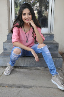 Actress Poonam Kaur Stills in Ripped Jeans at Attack Movie Audio Launch  0035.jpg