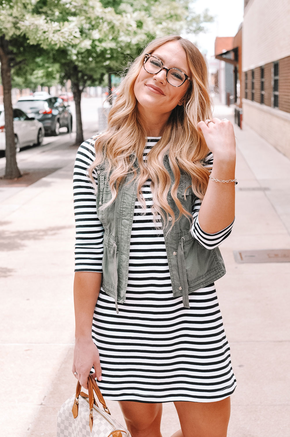 Oklahoma City blogger Amanda's OK wears a striped t-shirt dress and an olive vest with her James Avery onyx charm bracelet