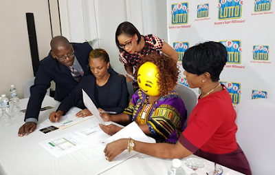 Lottery Winner Wears Mask To Collect Her $180,900,000 Prize [PHOTOS] - Image ~ Naijabang