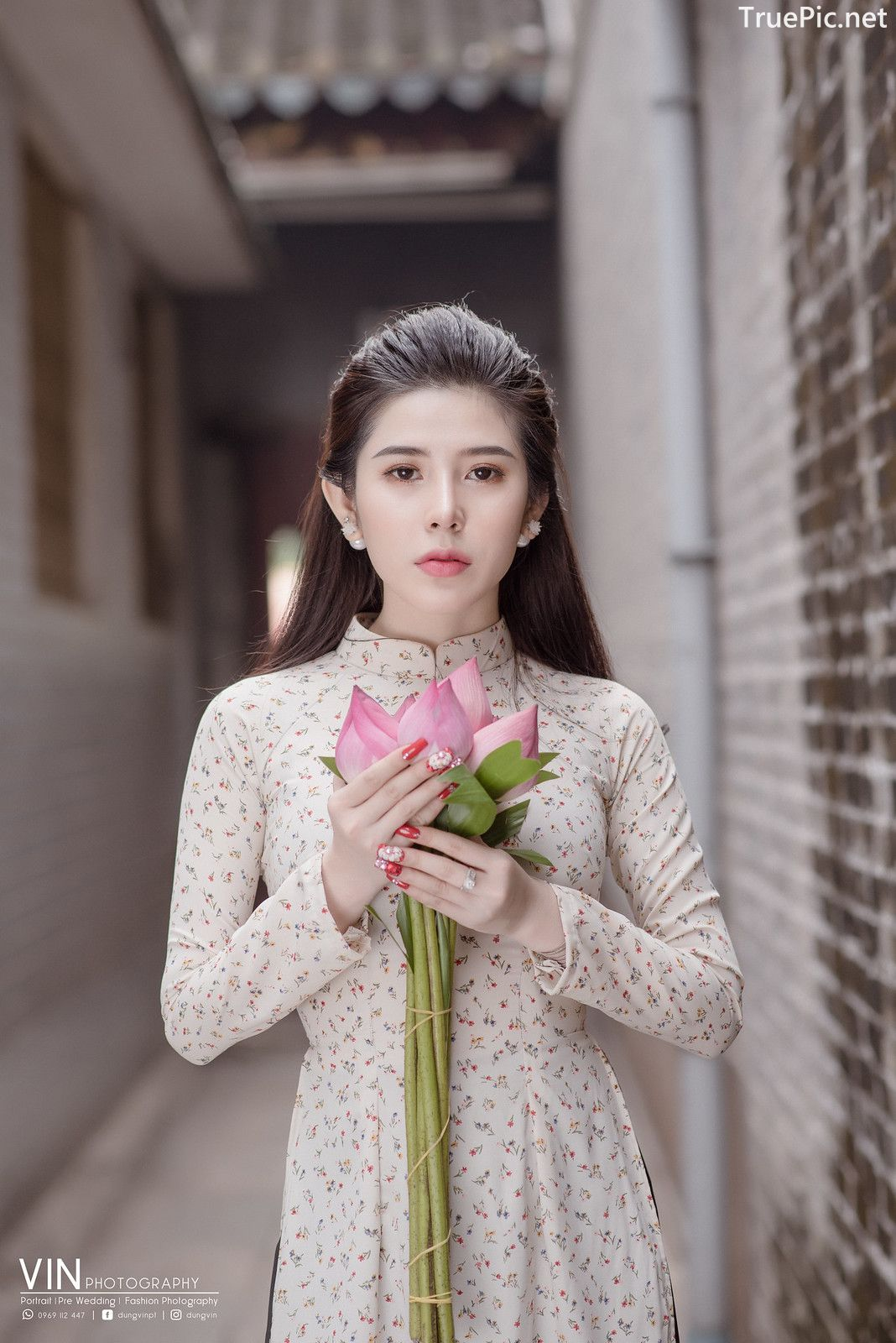 The Beauty of Vietnamese Girls with Traditional Dress (Ao