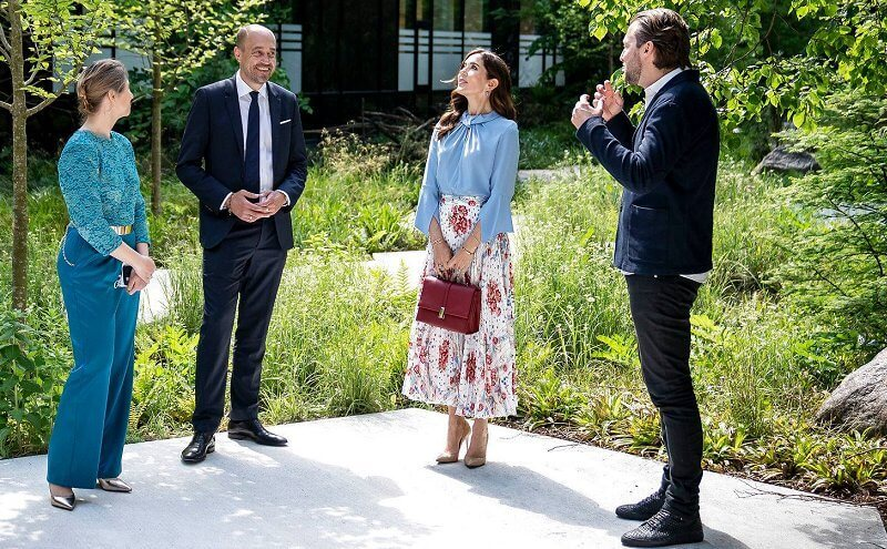 Crown Princess Mary wore a flare sleeve knot blouse from Victoria Beckham, and sunray pleated scarf print skirt from Paul and Joe