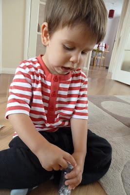 Child posting tin foil
