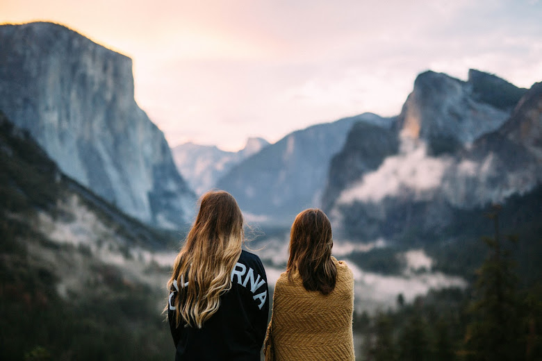 two women by mountains travelling