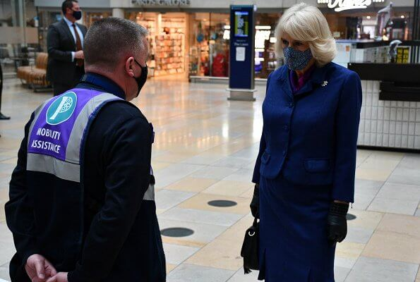 Duchess of Cornwall visited Paddington Station to watch a demonstration by the charity Medical Detection Dogs. blue navy blazer