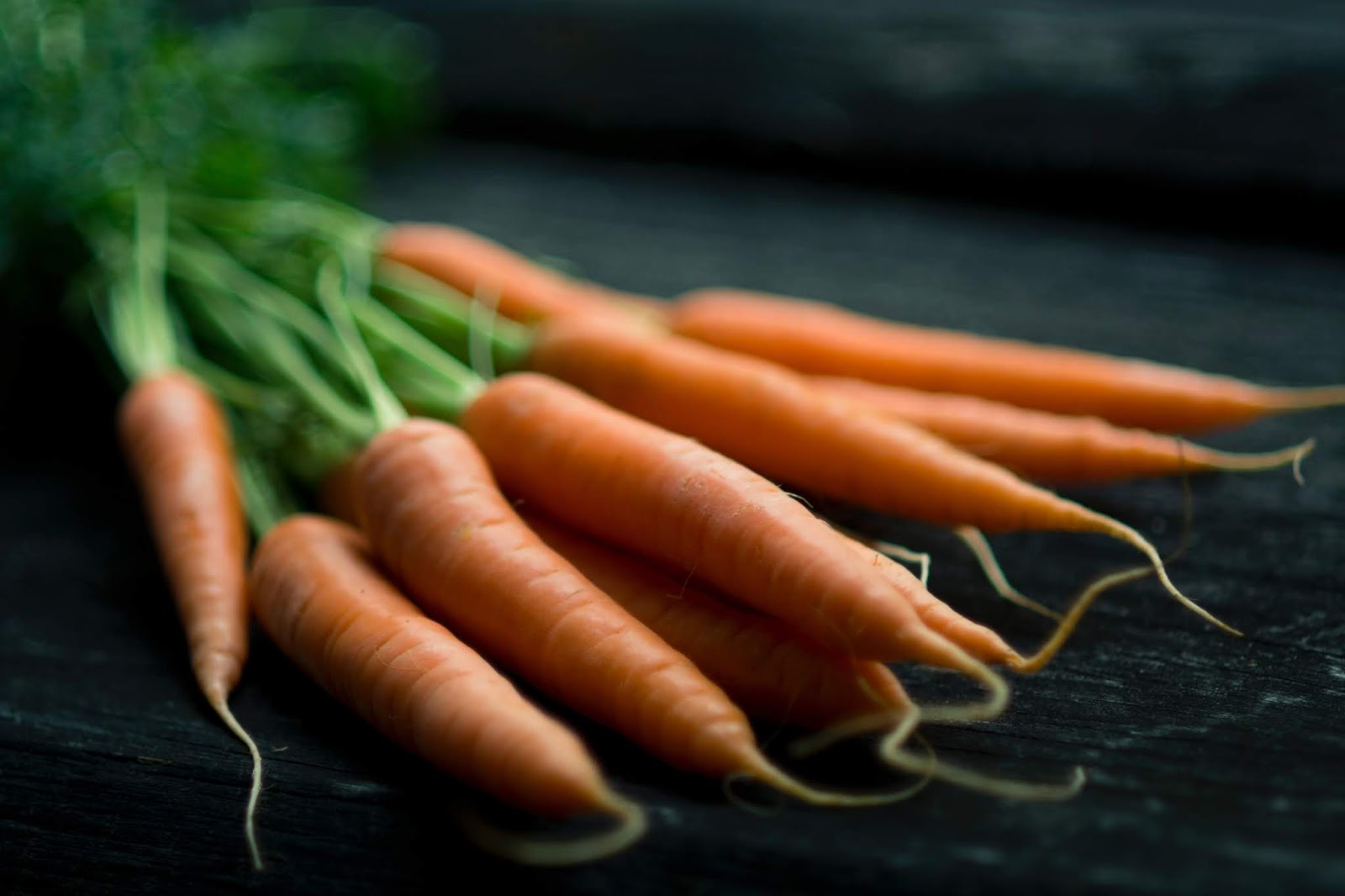 close up of fresh carrots on a table