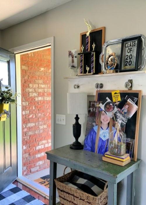 Graduation display at home- photos, awards, trophies