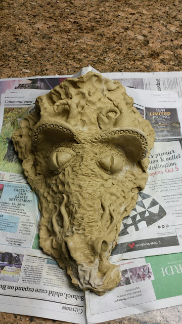 "Dragon mask formed from ""Little John"" clay by Lily L - work in progress."