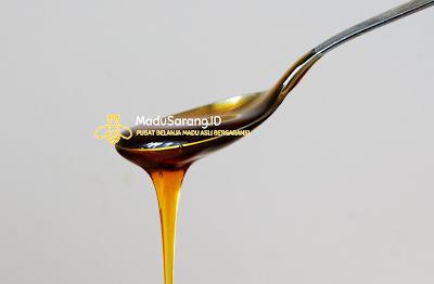 gambar tetesan madu dari sendok