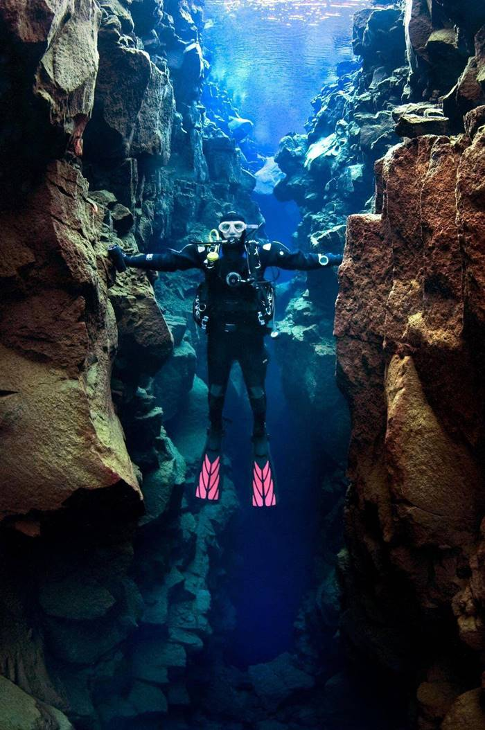 The space between North America and Europe, this diver is touching both continent.