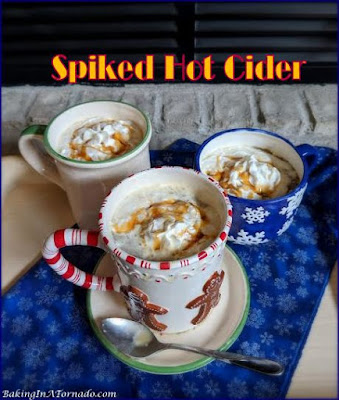 Spiked Hot Cider is a warm comforting drink for a cold day, a party or a holiday gathering. | Recipe developed by www.BakingInATornado.com | #recipe #drink