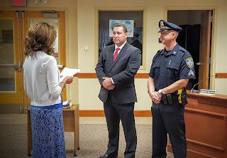 Asst Town Clerk Danello swears in Detective MacLean and Sargent Zimmerman