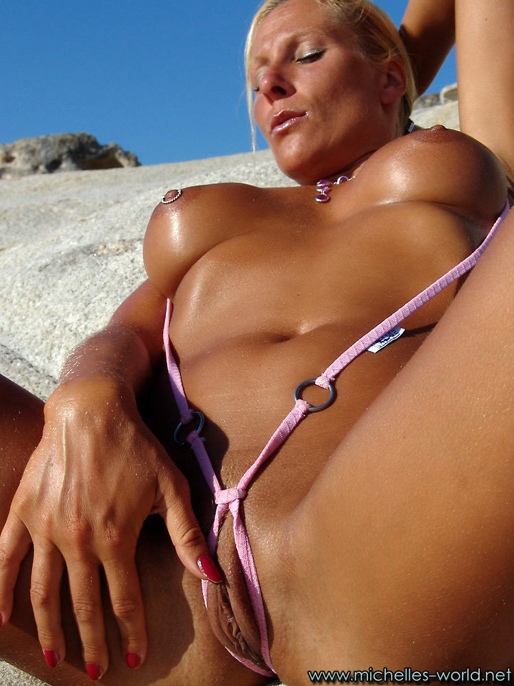 Mature blonde in g string bikini