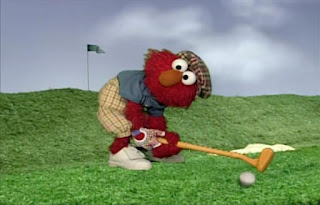 Dorothy imagines Elmo is a golfer. He makes a good shot and the ball comes pretty close to the hole. Elmo's World Balls Tickle Me Land
