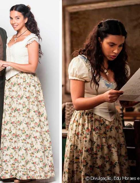 Juliana (Gabriela Moreyra) figurino de Escrava mãe, blusa branca e saia estampada