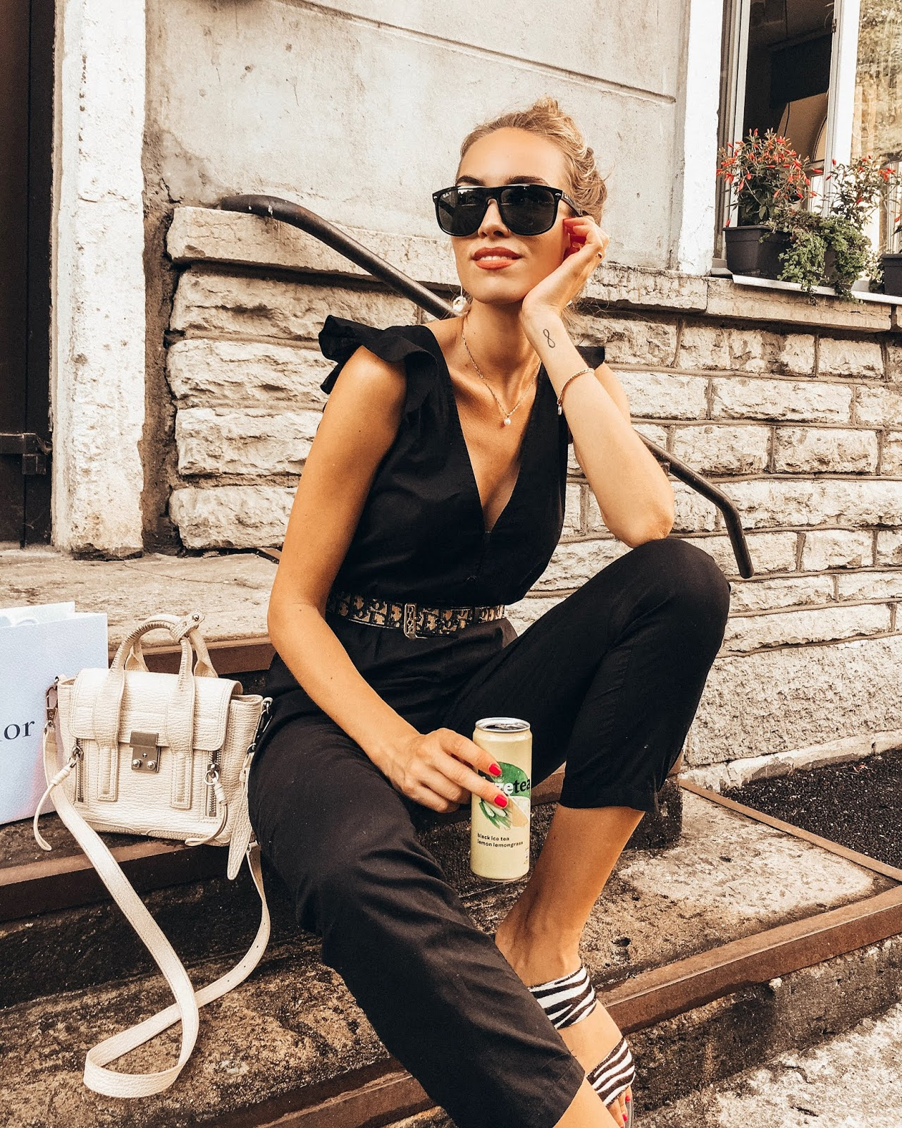 black jumpsuit dior belt 3.1 phillip lim mini pashli bag outfit