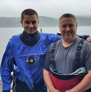 Joel and his dad after a drysuit dive in the Puget Sound