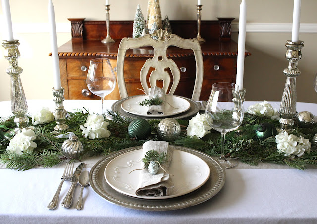 holiday tablescape greens silver mercury candleholders white christmas