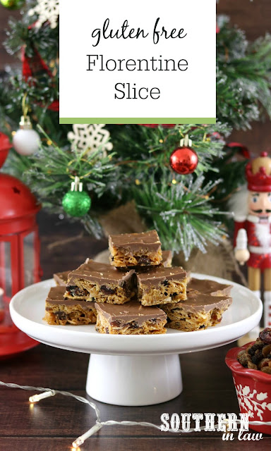 Easy Gluten Free Florentine Slice Recipe on a white raised platter in front of a Christmas tree