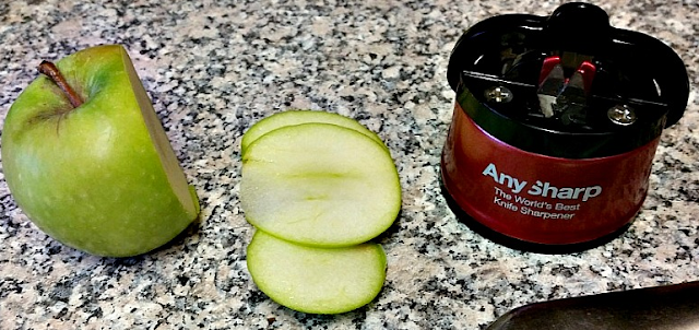 the anysharp knife sharpener along with a sliced apple