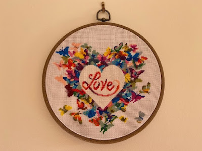 Heart cross stitch circular pattern in embroidery hoop