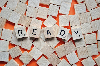 "Picture of Scrabble game tiles spelling ""Ready"""