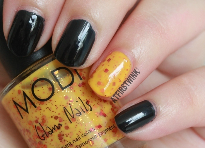 Halloween 2014: Black nails with a hint of pumpkin, used Aritaum Modi nail polishes