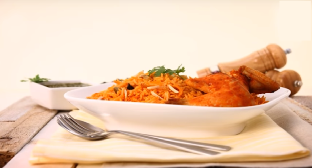 Bukhari Rice with Chicken in a serving dish Bukhari Rice with Chicken Recipe