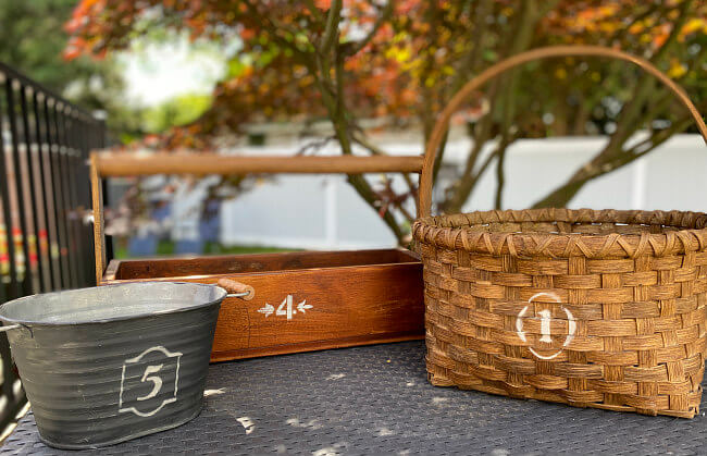 group of baskets with new crock stenciled numbers