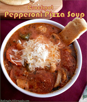 Crockpot Pepperoni Pizza Soup is a fun and filling way to have your soup and pizza too, pizza night in a quick and easy slow cooker soup form. | Recipe developed by www.BakingInATornado.com | #recipe #dinner