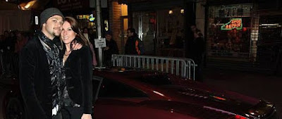 Missy Rothstein posing for picture with her ex-husband Bam in front of car