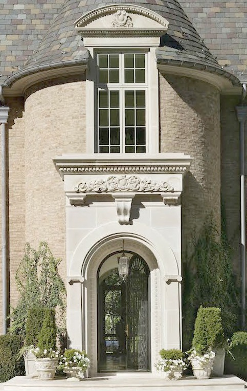 Elegant French limestone entrance to Enchanted Home French chateau