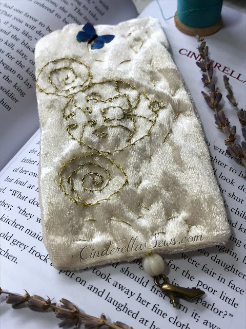 Cinderella Coach Hand Embroidered Bookmark - This keepsake bookmark features metallic gold thread, Swarvski and Czech glass beads, and a tiny brass slipper shoe charm for book lovers looking for a special bookmark. Click for m ore information about the bookmark and artist who makes it! #cinderella #handmadegifts #supportsmallbusiness #handembroidery #fairytale #onceuponatime #cinderella2015 #cinderellaaesthetic #bookmark